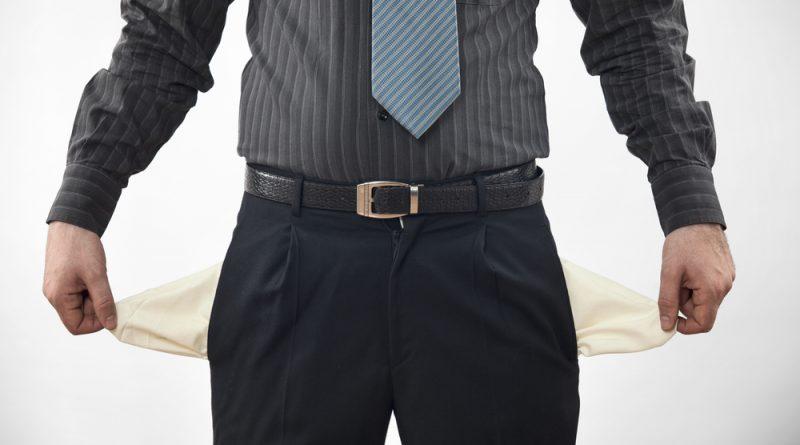 Man holding empty pockets